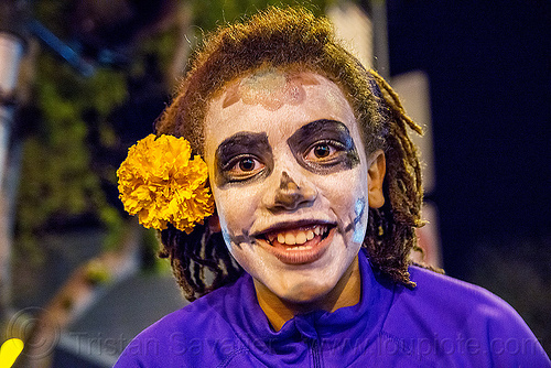 black teenage girl with skull makeup - dia de los muertos, day of the dead, dia de los muertos, dreadlocks, dreads, face painting, facepaint, halloween, marigold flower, night, skull makeup, teen, teenage girl, teenager, woman