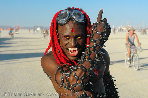 black vampire, african american man, arm, bicolor contact lenses, bindis, black man, burning man, color contact lenses, contacts, damon knight, dreadlocks, dreads, goggles, leather, red hair, special effects contact lenses, spikes, theatrical contact lenses, vampire fangs