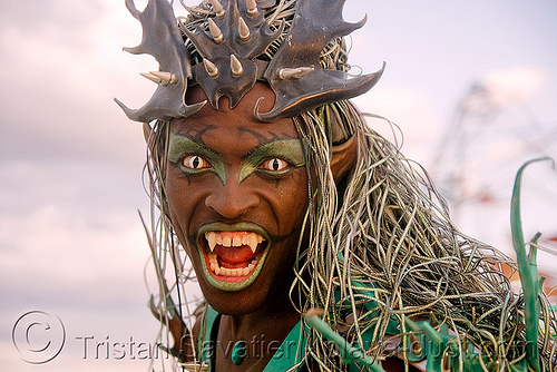 black vampire with cat-eye contacts, african american man, black man, burning man, cat eyes, cat-eye contact lenses, color contact lenses, damon knight, green, people, special effects contact lenses, teeth, theatrical contact lenses, vampire fangs