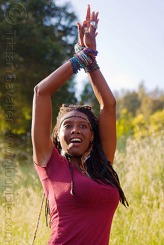 black woman dancing - arms up, black woman, bracelets, dancing, headband, lala love, spring training, thin dreadlocks