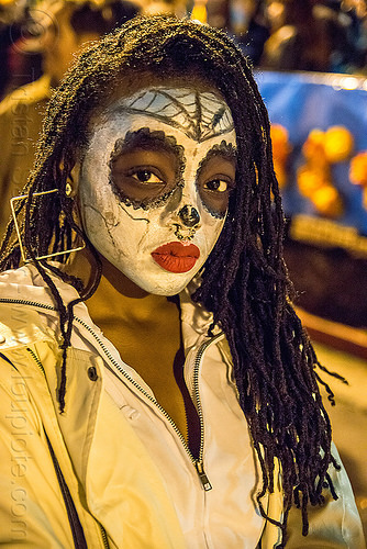 black woman with white sugar skull makeup - dia de los muertos, day of the dead, dia de los muertos, dreadlocks, dreads, face painting, facepaint, halloween, night, nose piercing, red lipstick, septum piercing, square earrings, sugar skull makeup, woman