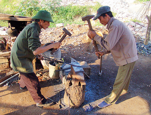 blacksmiths hammering hot iron on anvil - vietnam, anvil, blacksmiths, hammering, hammers, ironwork, ironworking, lang sơn, men, metalwork, metalworking, vietnam, workers, working