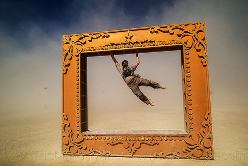 BLM officer swinging in giant frame - burning man 2016, art installation, blm, burning man, cop, giant frame, got framed, hanging, law enforcement officer, leo, police, swinging