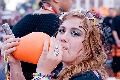 blowing a balloon, balloon, blowing, how weird festival, whip it, woman