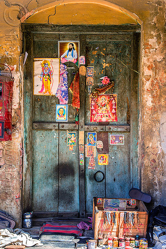blue door decorated with posters of hindu deities and gurus (india), blue door, closed, deities, hindu, hinduism, india, posters, varanasi