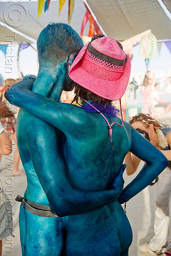 body-painted couple - A & J - burning man 2009, blue, body art, body paint, body painting, burning man, center camp, couple, green, pink hat, straw hat, woman