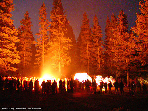 bonfire-and-fire-dancers - rainbow gathering - hippie, bonfire, crowd, fire dancers, fire spinners, forest, glowing, hippie, night, silhouettes, trees