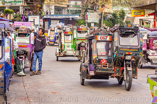 bontoc - motorized tricycles (philippines), bontoc, colorful, man, motorcycles, motorized tricycle, pedestrian, philippines, sidecar, standing