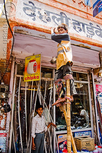 boy begging on stilts - jaipur (india), beggar, begging, boy, child, jaipur, pan handling, stilts, stiltwalker, stiltwalking, street kid