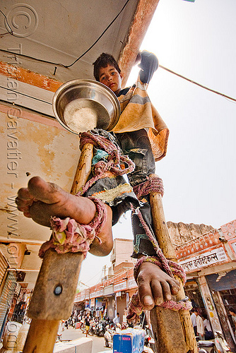 boy begging on stilts - jaipur (india), bare feet, barefoot, beggar, begging, boy, child, jaipur, pan handling, ropes, stilts, stiltwalker, stiltwalking, street kid
