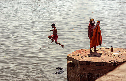 boy jumping from a ghat into the ganges river (varanasi), baba, boy, ganga, ganges river, ghats, hindu, hinduism, india, jump, men, river bank, sadhu, varanasi
