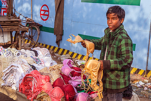 boy selling bras (india), delhi, holding, market, merchant, people, stall, street market, street vendor
