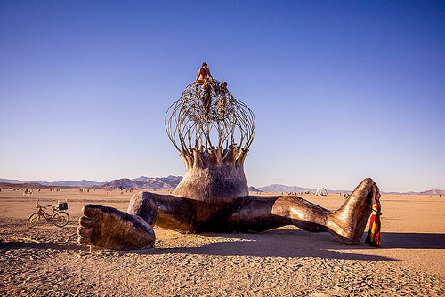 brainchild - burning man 2015, art installation, brainchild, burning man, cage, giant baby, michael christian, sculpture, sitting