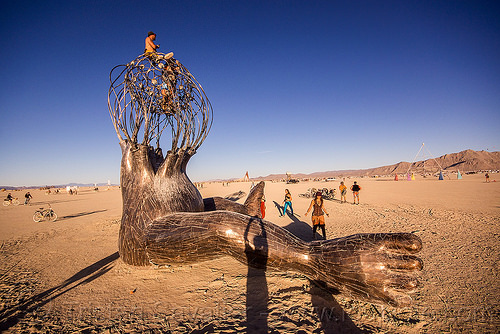brainchild - burning man 2015, art installation, brainchild, burning man, cage, giant baby, legs, metal, michael christian, sculpture, sitting