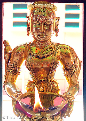 brass statue of a kho me goddess - deity (saigon) - vietnam, brass, burning, female, fire, flames, goddess, golden color, khmer krom, kho-me, metal, sculpture, statue, temple, woman