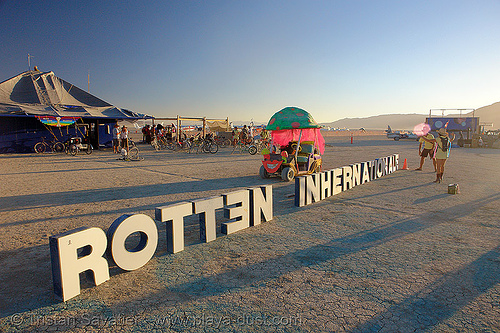 the BRC airport's name keeps changing! - burning-man 2006, black rock city airport, brc airport, burning man airport, international airport, letters, sign