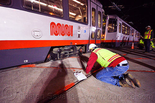 breda LRV test train, ansaldo breda, breda lrv, high-visibility jacket, high-visibility vest, light rail, man, muni, ntk, railroad construction, railroad tracks, railway tracks, reflective jacket, reflective vest, safety helmet, safety vest, san francisco municipal railway, test train, track maintenance, track work, tram, worker