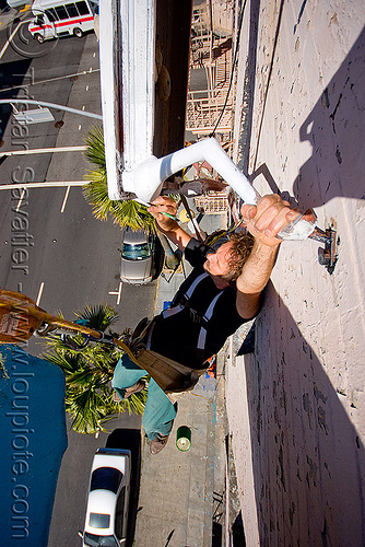 brian goggins restoring the defenestration building (san francisco), artist, brian goggins, cars, defenestration building, hanging, man, paint, painting, restoration, rope access, ropework, safety harness, street, table, wall
