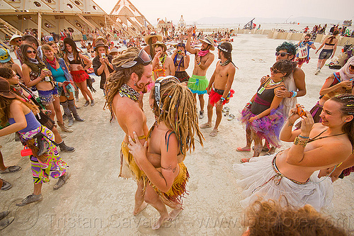 bride and groom dancing at their handfasting - burning man 2013, bride, burning man, couple, dancing, groom, handfasting, temple of whollyness, wedding
