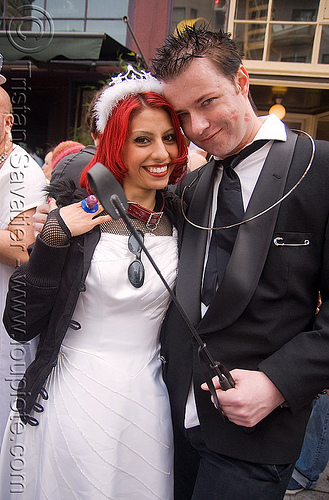 bride and groom with whip - brides of march (san francisco), brides of march, couple, festival, man, red hair, wedding, whip, white, woman