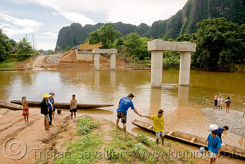 bridge not finished - use canoes to cross river (laos), bridge construction, bridge piers, bridge pillars, ferry boats, kong lor, laos, river crossing