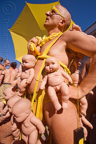 bruce beaudette with his babies, baby dolls, costume, folsom street fair, man, people, yellow