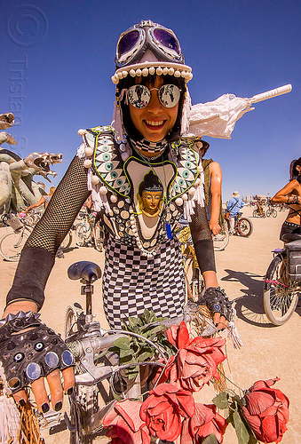 buddha costume - burning man 2015, bicycle, buddha, checkered dress, costume, fingerless gloves, goggles, riding, sunglasses, white umbrella, woman