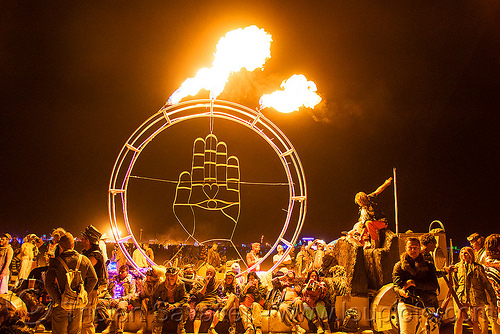 buddha hand with fire - burning man 2016, buddha hand, buddhism, burning man, circle, crowd, fire, mutant vehicles, night, unidentified art car