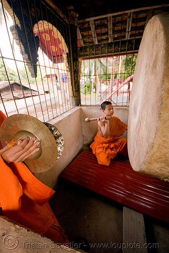 buddhist monk with big drum - luang prabang (laos), bhagwa, buddhism, buddhist monks, drum, laos, luang prabang, monk, orange, saffron color