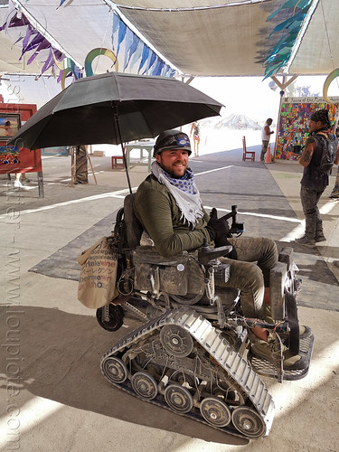 burner in tracked wheelchair- burning man 2019, burning man, paralyzed, paraplegic, soldier, tracked wheelchair, umbrella