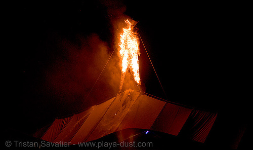 burning man set on fire early due to arson - burning man 2007, burning man, early burn, fire, first burn, first man, flames, man burns early, night, the man