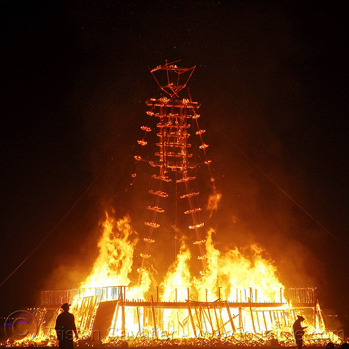 the burnt frame of the man is still standing - burning man 2015, burning man, chared, embers, fire, flames, frame, night of the burn, silhouettes, the man