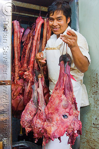 butcher holding beef head, beef, butcher, cow head, man, meat market, meat shop, mercado central, noroeste argentino, raw meat, salta