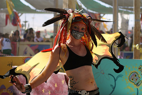 butterfly costume - burning man 2007, aries, backlight, burning man, butterfly costume, feathers, woman
