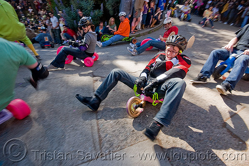 "BYOBW - ""bring your own big wheel"" race - toy tricycles (san francisco), bicycle helmet, drift trikes, fast, moving, moving fast, people, potrero hill, speed, speeding, toy tricycle, toy trike, trike-drifting"