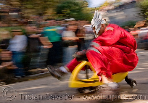 "BYOBW - ""bring your own big wheel"" race - toy tricycles (san francisco), big wheel, drift trikes, moving fast, potrero hill, race, red, speed, speeding, toy tricycle, toy trike, trike-drifting"