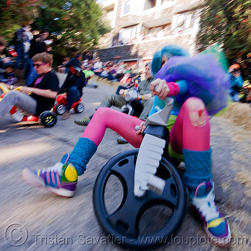 "BYOBW - ""bring your own big wheel"" race - toy tricycles (san francisco), blue wig, byobw 2011, drift trikes, fast, moving, moving fast, people, pink tights, potrero hill, speed, speeding, toy tricycle, toy trike, trike-drifting, tutu, woman"