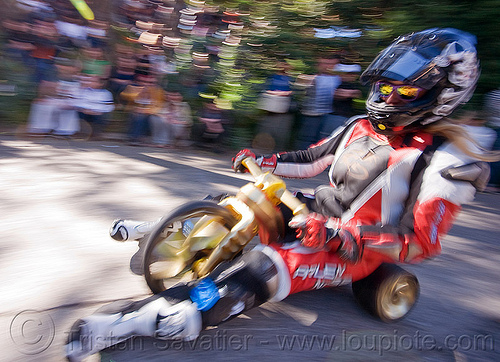 "BYOBW - ""bring your own big wheel"" race - toy tricycles (san francisco), big wheel, byobw 2011, drift trikes, full face helmet, motorcycle helmet, motorcycle racer costume, moving fast, potrero hill, race, speed, speeding, toy tricycle, toy trike, trike-drifting"