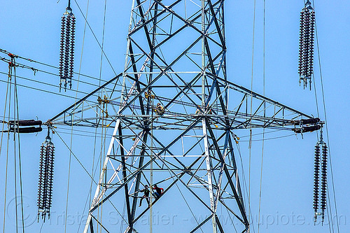 cable riggers installing power lines on transmission tower (india), cable riggers, cables, construction, electric line, electricity pylon, high voltage, india, men, power transmission lines, pulleys, rigging, safety harness, wires, workers