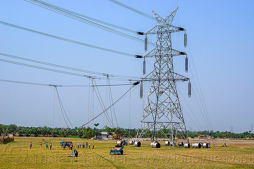 cable riggers installing power lines on transmission tower (india), cable wheels, cables, construction, electric, electric line, electricity, electricity pylon, high voltage, industrial, infrastructure, men, people, power transmission lines, pulleys, rigging, ropes, wires, workers