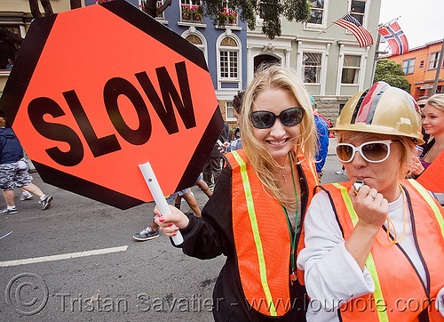 caltrans workers with stop sign, bay to breakers, caltrans, costume, festival, footrace, high-visibility jacket, high-visibility vest, people, reflective jackets, reflective vest, safety helmet, safety jackets, slow sign, street party, woman, workers