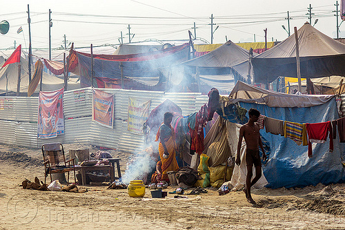 camp on the street - kumbh mela 2013 (india), camp-fire, camping, encampment, hindu pilgrimage, hinduism, india, maha kumbh mela, pilgrims, smoke, smoking, street seller, tents