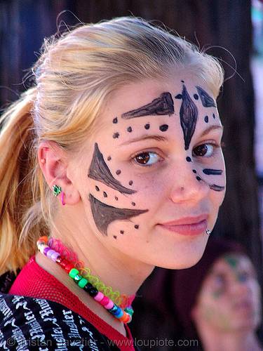 candy kid girl with face paint - burning man decompression 2007 (san francisco), beads, child, face painting, facepaint, kandi kid, kandi raver, little girl, necklace, piercing, raver outfits, stranger, teenager, woman