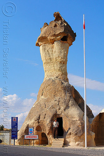 cappadocia fairy chimney - police station in a hoodoo - jandarma (turkey), architecture, cappadocia, cave dwellings, caves, cop, erosion, fairy chimney, flag pole, geology, göreme, hoodoo, jandarma, law enforcement, man, police post, police station, road, rock formations, rock house, signs, tent rock, troglodyte, turkish police, uniform, volcanic tuff