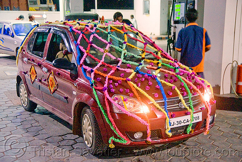 car decorated for wedding (india), decorated car, indian wedding, just married, newly wed, street, tata indica v2, tata motors