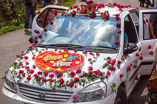 car decorated with rose flowers - indian wedding, decorated car, flowers, indian wedding, just married, red, roses, sign, tata indica, tata motors, tola gunth, white