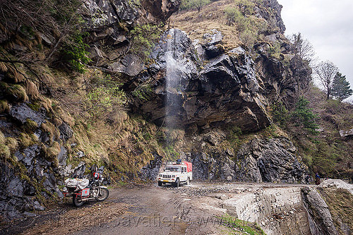 car gets shower from waterfall - gangotri road (india), 4x4, bhagirathi valley, car, dripping, india, jeep, motorcycle, mountain road, mountains, overhanging rock, shower, waterfall