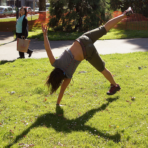 cartwheeling on one hand, cartwheeling, catrwheel, grass, gymnastics, jessika, one hand, shadow, single handed, turf, upside-down, woman