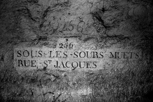 carved plate - catacombes de paris - catacombs of paris (off-limit area), carved plate, cave, clandestines, illegal, paris, sign, sourds-muets, sours-muets, trespassing, underground quarry