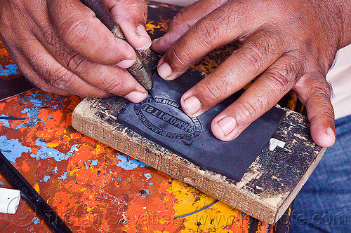 carving a rubber stamp, carving, cutter, etching, hands, java, jogja, jogjakarta, rubber stamp, street merchant, street vendor, yogyakarta